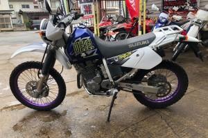 Синий Suzuki Djebel 250 XC 1997