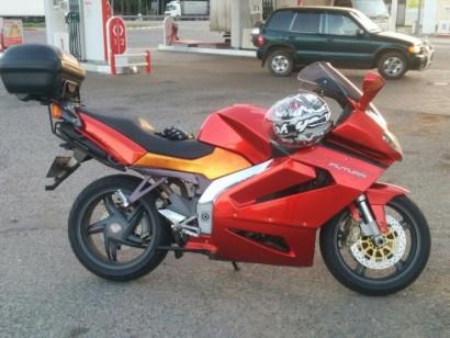В угоне красный металлик Aprilia RST 1000 Futura 2001